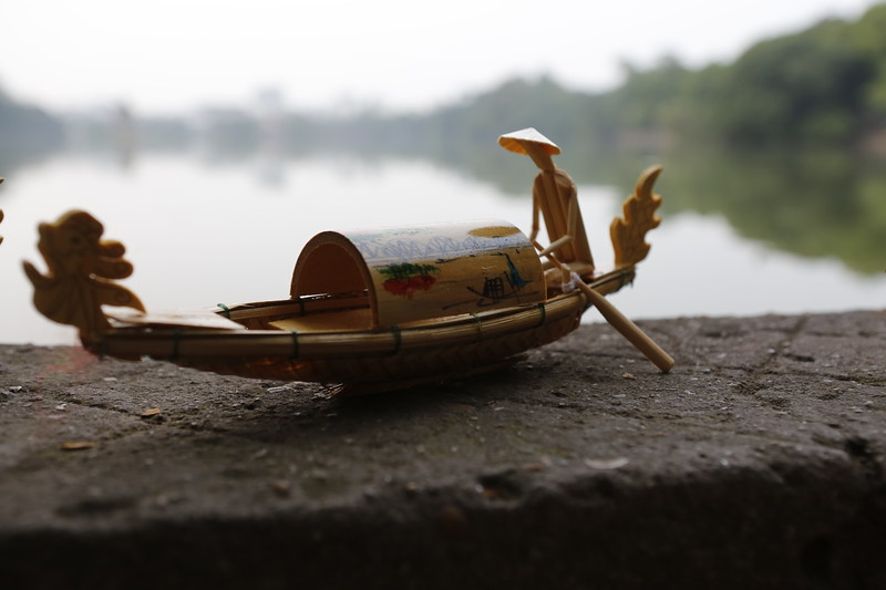 Intricate wooden boat with moving parts
