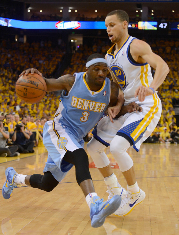 . OAKLAND, CA - APRIL 28:Ty Lawson (3) of the Denver Nuggets drives on Stephen Curry (30) of the Golden State Warriors during the second quarter in Game 3 of the first round NBA Playoffs April 28, 2013 at Oracle Arena. (Photo By John Leyba/The Denver Post)