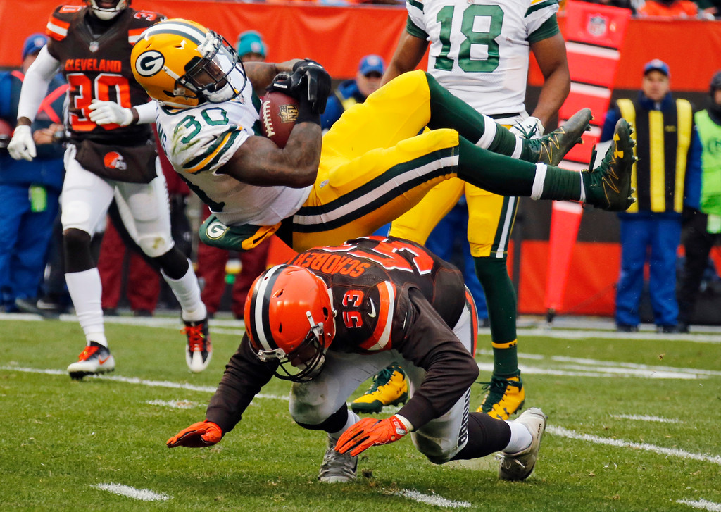 . Green Bay Packers running back Jamaal Williams (30) is upended by Cleveland Browns outside linebacker Joe Schobert (53) in the second half of an NFL football game, Sunday, Dec. 10, 2017, in Cleveland. (AP Photo/Ron Schwane)