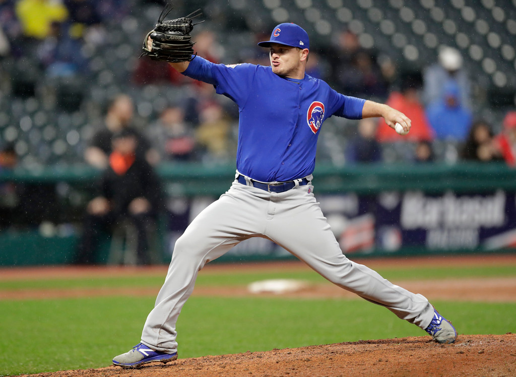 . Chicago Cubs relief pitcher Justin Wilson delivers in the eighth inning of a baseball game against the Cleveland Indians, Tuesday, April 24, 2018, in Cleveland. (AP Photo/Tony Dejak)