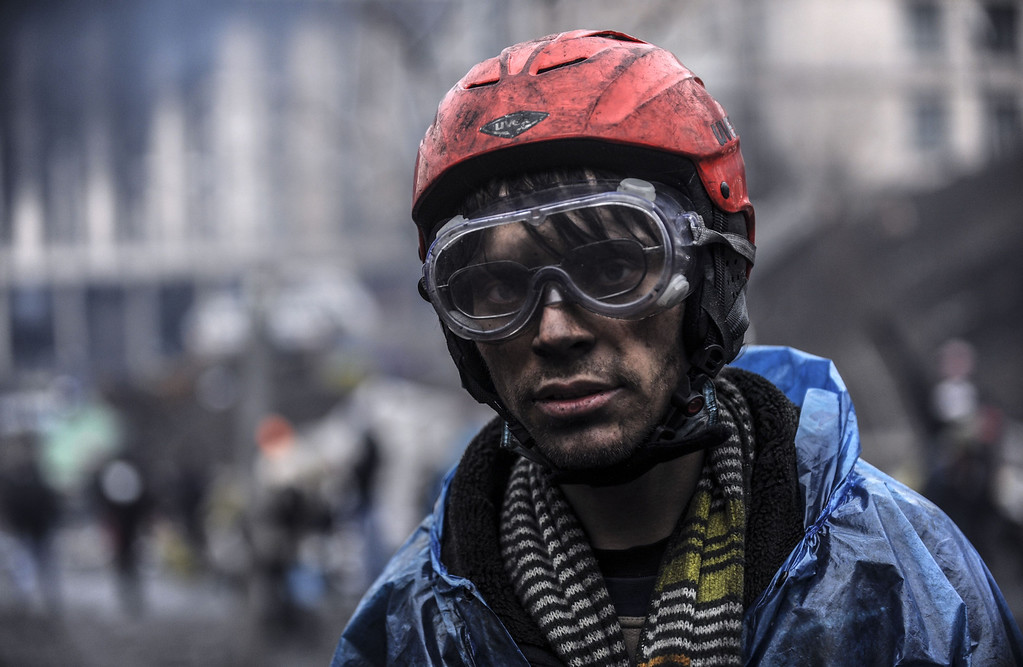 . A protestor stands near barricades during clashes with riot police in central Kiev on February 20, 2014 in Kiev.  AFP PHOTO/BULENT KILIC/AFP/Getty Images
