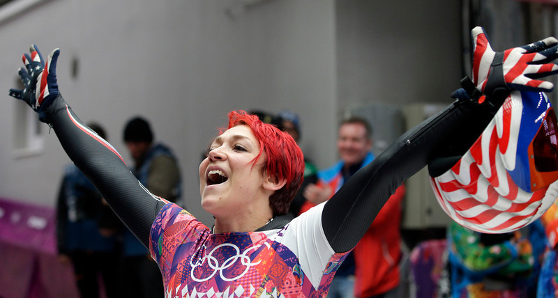 . Katie Uhlaender of the United States waves to fans after her final run during the women\'s skeleton competition at the 2014 Winter Olympics, Friday, Feb. 14, 2014, in Krasnaya Polyana, Russia. (AP Photo/Michael Sohn)