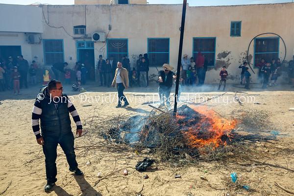 TUNISIA, Djerba, Hara Kebira. Burning Haman's effigy for Purim (3.2016)