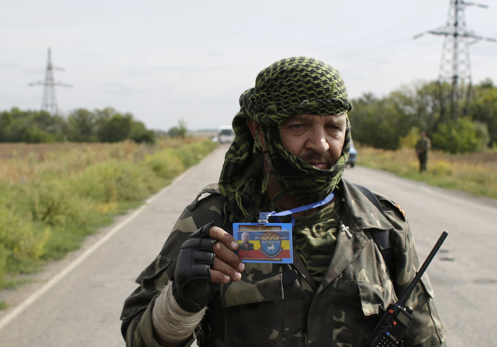 . A pro-Russian militant shows his ID card as he speaks to the Ukrainian press on September 10, 2014 in the middle of a road controled by rebels on one side and by Ukrainian forces on the other side, near the small eastern Ukrainian city of Slavyanoserbsk, in the Lugansk region.  AFP PHOTO/ ANATOLII STEPANOVANATOLII STEPANOV/AFP/Getty Images