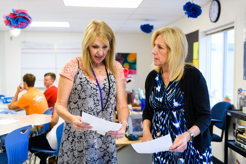 Teachers Linda Olson, left, and Robin Yankus compare their schedules in the newly-built portable classrooms. Back to school day at McNary High School on Wednesday, September 4, 2019 in Keizer, Ore.