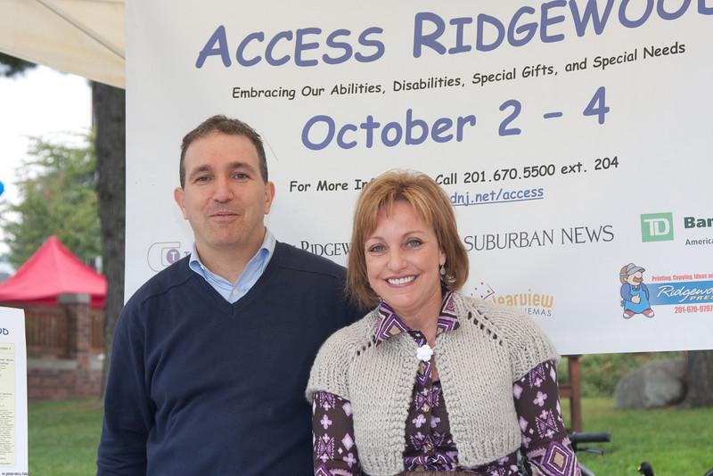 (1) Slug #: W 24464; (2) Ridgewood, NJ; (3) 10/03/09; (4) Ridgewood Community Access Network Presents Access Ridgewood on 10/3/2009; (5) Village of Ridgewood Councilman Paul Aronsohn with Linda Walder Fiddle, founder and executive director of the Daniel Jordan Fiddle Foundation, welcoming performers and guests to the Community Acces Network's Access Ridgewood performance on 10/3/2009; (6) W.H. GRAE for the Ridgewood News.
