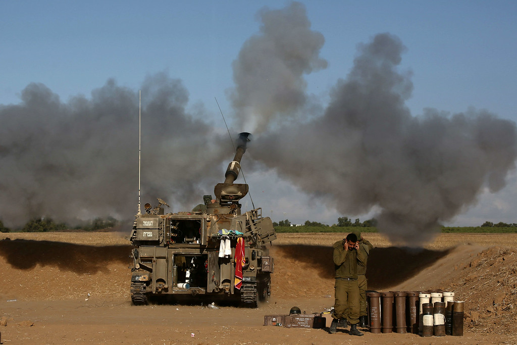 . A 155mm artillery, positioned near the Israeli border with the Gaza Strip, fires a projectile towards targets in the Palestinian enclave, on July 17, 2014. Israel and the Islamist Hamas movement have agreed on a ceasefire that will begin at 0300 GMT on Friday, an Israeli official told AFP. AFP PHOTO /MENAHEM  KAHANA/AFP/Getty Images