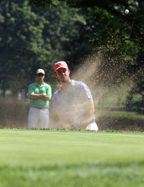 Alex Moon of Dallas, Texas successfully saves par thanks to this sand shot in his opening match at the 2012 Western Amateur Championship at Exmoor Country Club in Highland Park, IL on Friday, Aug. 3, 2012. (WGA Photo/Ian Yelton)