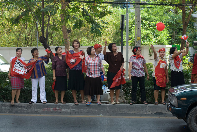 Women waiting on protest convoy in Thailand