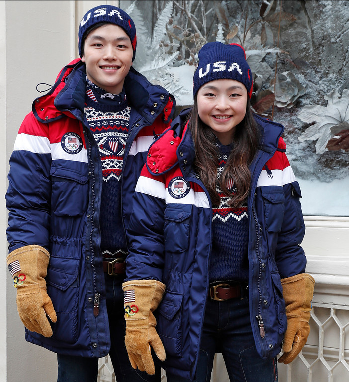. Ice dancing pair Alex and Maia Shibutani, a brother and sister team, pose for photographs wearing Team USA Opening Ceremony uniforms designed by David Lauren for Polo Ralph Lauren, Monday, Jan. 22, 2018, outside the brand\'s Prince Street store in New York. The parkas have a battery-operated, built-in heating element that can be adjusted using a cell phone. (AP Photo/Kathy Willens)