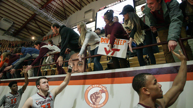 The Hokies high five fans around the perimeter of Cassell after the game. The Hokies defeated Syracuse 83-73. (Mark Umansky/TheKeyPlay.com)