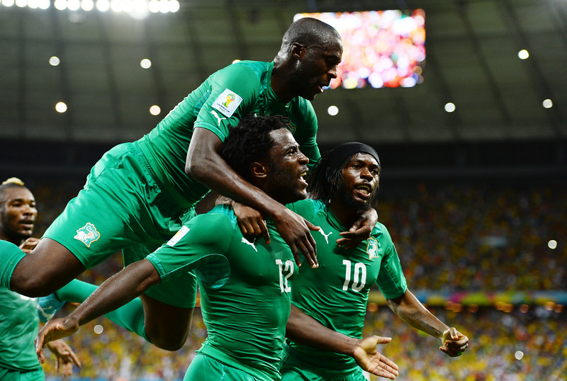 . Wilfried Bony of the Ivory Coast (C) celebrates scoring his team\'s first goal with Yaya Toure (L) and Gervinho during the 2014 FIFA World Cup Brazil Group C match between Greece and the Ivory Coast at Castelao on June 24, 2014 in Fortaleza, Brazil.  (Photo by Jamie McDonald/Getty Images)