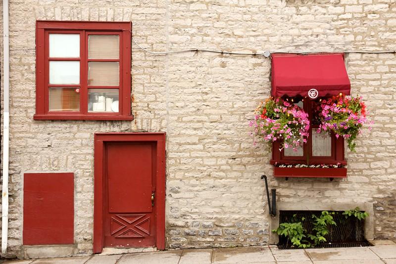 Windows and hanging flower pots on Rue du Parloir. Quebec City, Canada.
