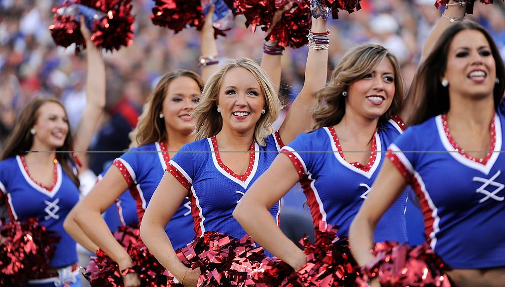 . Buffalo Bills cheerleaders perform during the first half of an NFL preseason football game against the Minnesota Vikings Friday, Aug. 16, 2013, in Orchard Park, N.Y.  (AP Photo/Gary Wiepert)