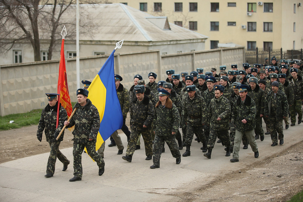 . Unarmed Ukrainian troops bearing their regiment and the Ukrainian flags march to confront soldiers under Russian command occupying the Belbek airbase in Crimea on March 4, 2014 in Lubimovka, Ukraine. (Photo by Sean Gallup/Getty Images)