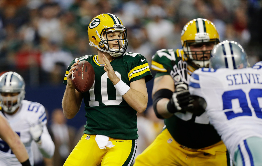 . Green Bay Packers quarterback Matt Flynn (10) rolls back to pass against the Dallas Cowboys during the first half of an NFL football game, Sunday, Dec. 15, 2013, in Arlington, Texas. (AP Photo/Tim Sharp)