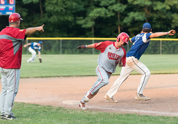 07/16/18 Wesley Bunnell | Staff Bristol defeated Plainville in legion baseball on Monday night at Trumbull Park in Plainville. Alec Diloreto (14) is sent home by the third base coach.