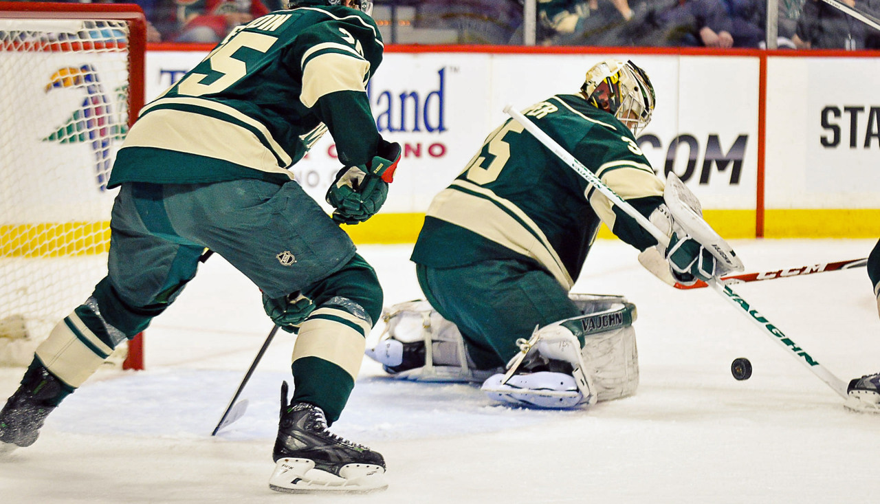 . Wild goalie Darcy Kuemper makes a stop in the first period as defenseman Jonas Brodin follows the play against the Avalanche in the first period.  (Pioneer Press: Ben Garvin)