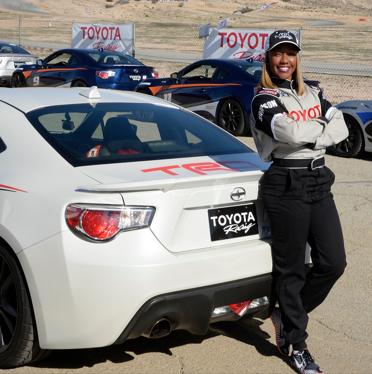 . March 15,2014. Rosamond CA.  American sprinter olympic gold, silver and bronx medalist Carmelita Jeter poses for photos, as celebrities in the Long Beach Grand Prix practice racing with instructors in Toyota race cars at the Willow Springs International Raceway. photo  by Gene Blevins/LA DailyNews