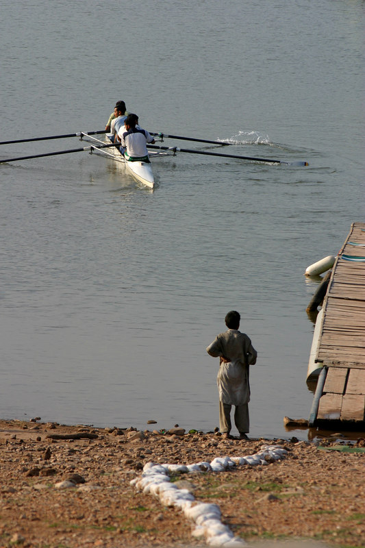 A prospective rower watches from shore.