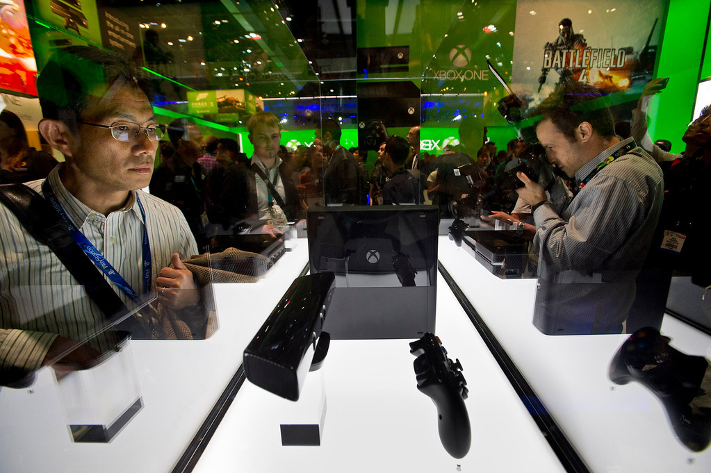 . Visitors get a close look at the Xbox One during E3 Expo at the Los Angeles Convention Center on Tuesday, June 11, 2013. E3 is the world\'s largest video game industry show. (Staff photo by Watchara Phomicinda/ Los Angeles Media News Group)