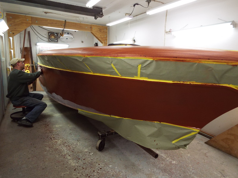 Stain being applied to the starboard side.