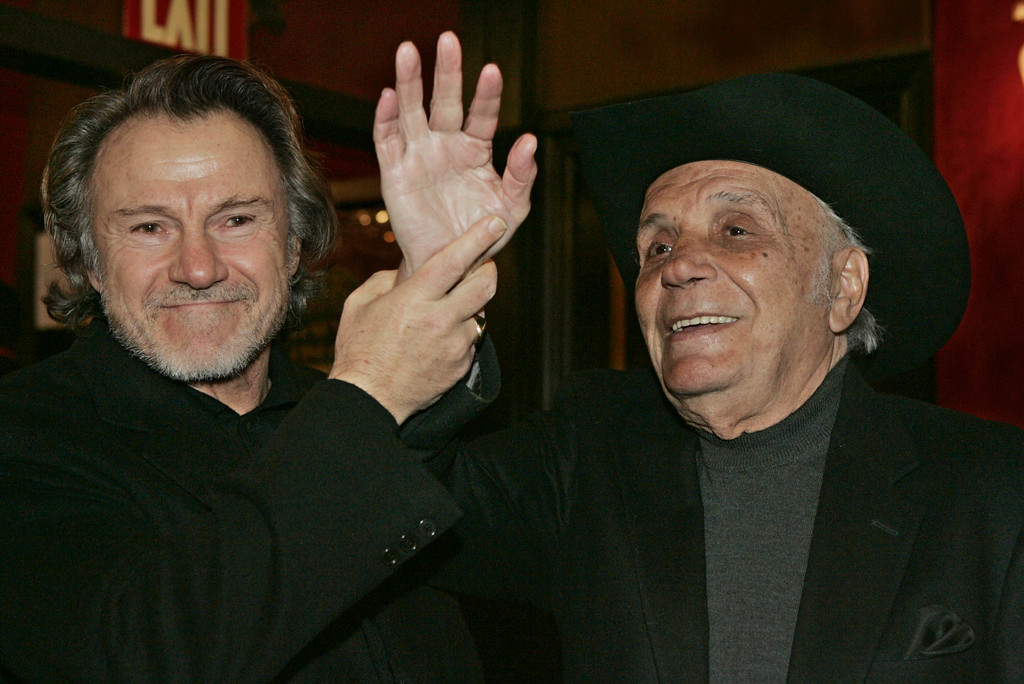 """. \""""Raging Bull\"""" author and boxer Jake LaMotta, right, jokes with Harvey Keitel before watching a 25th anniversary screening of the movie Thursday, Jan. 27, 2005 in New York. An anniversary collector\'s edition DVD of the film was also released. (AP Photo/Julie Jacobson)"""