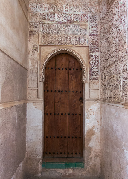A moorish archway and carving in the Alhambra.