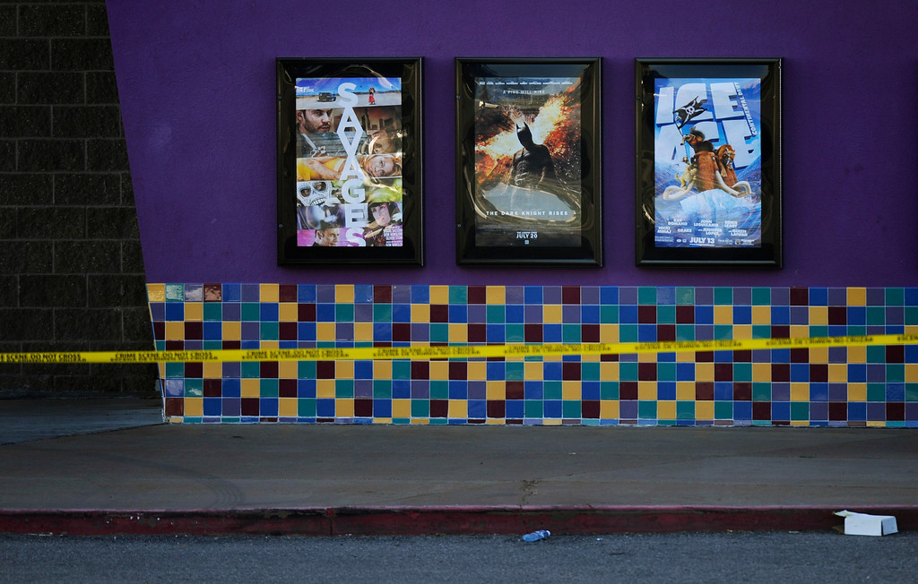 . The movie poster for the movie Dark Knight Rises still hangs, Tuesday, July 24, 2012, outside Century Aurora 16 Multiplex, Tuesday, July 24, 2012.  RJ Sangosti, The Denver Post.