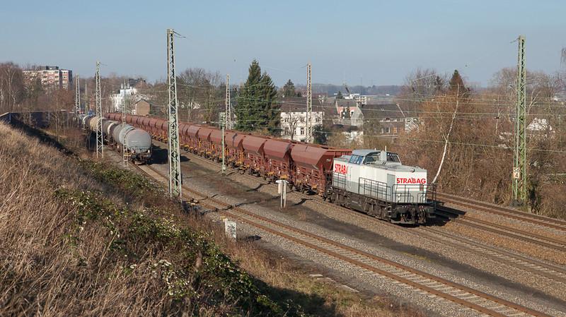 Strabag 203 166 on a ballast train eastbound in Eschweiler.