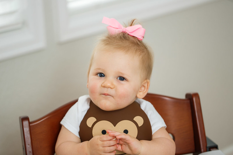 Make_My_Day_Bib_Lifestyle_Monkey_Girl_In_Highchair_Looking_At_Camera.JPG