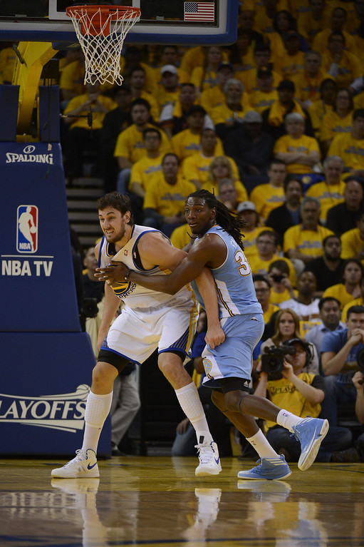 . OAKLAND, CA. - APRIL 26: Kenneth Faried (35) of the Denver Nuggets and Andrew Bogut (12) of the Golden State Warriors battle for position in game 3 of the first round of the NBA Playoffs April 26, 2013 at Oracle Arena.  (Photo By John Leyba/The Denver Post)