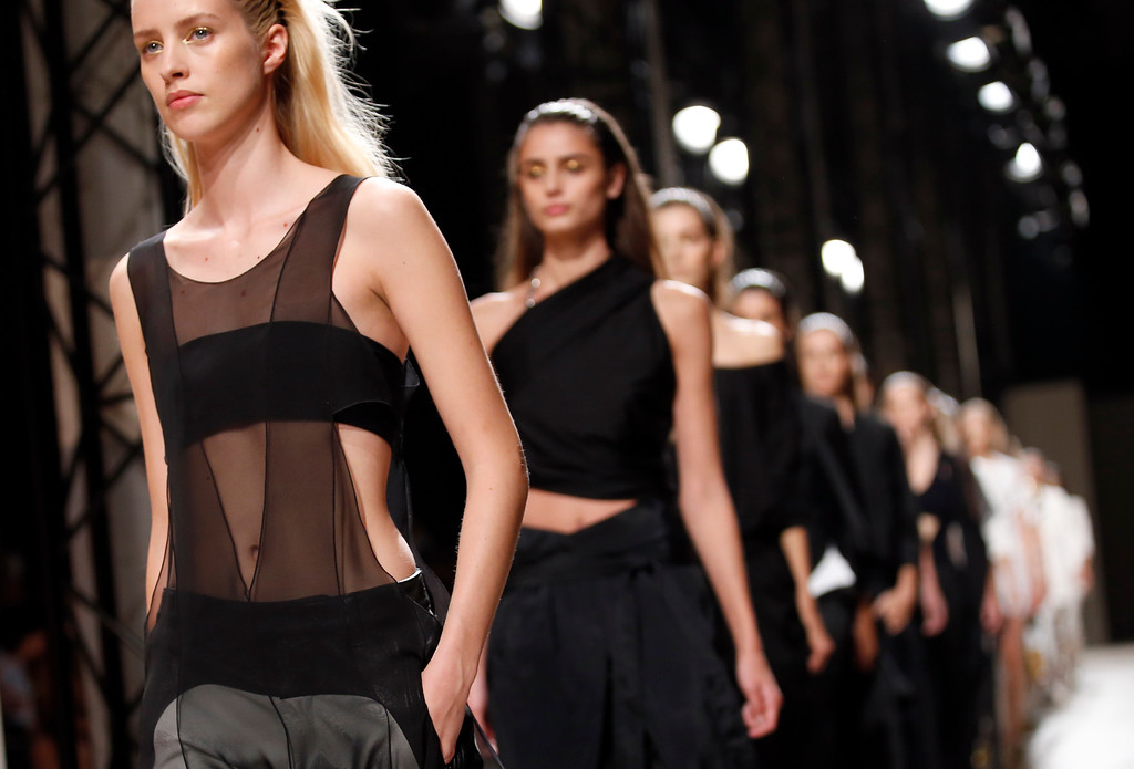 . Models wear creations from French fashion designer Barbara Bui\'s Spring/Summer 2015 ready-to-wear fashion collection presented in Paris, France, Thursday, Sept. 25, 2014. (AP Photo/Francois Mori)