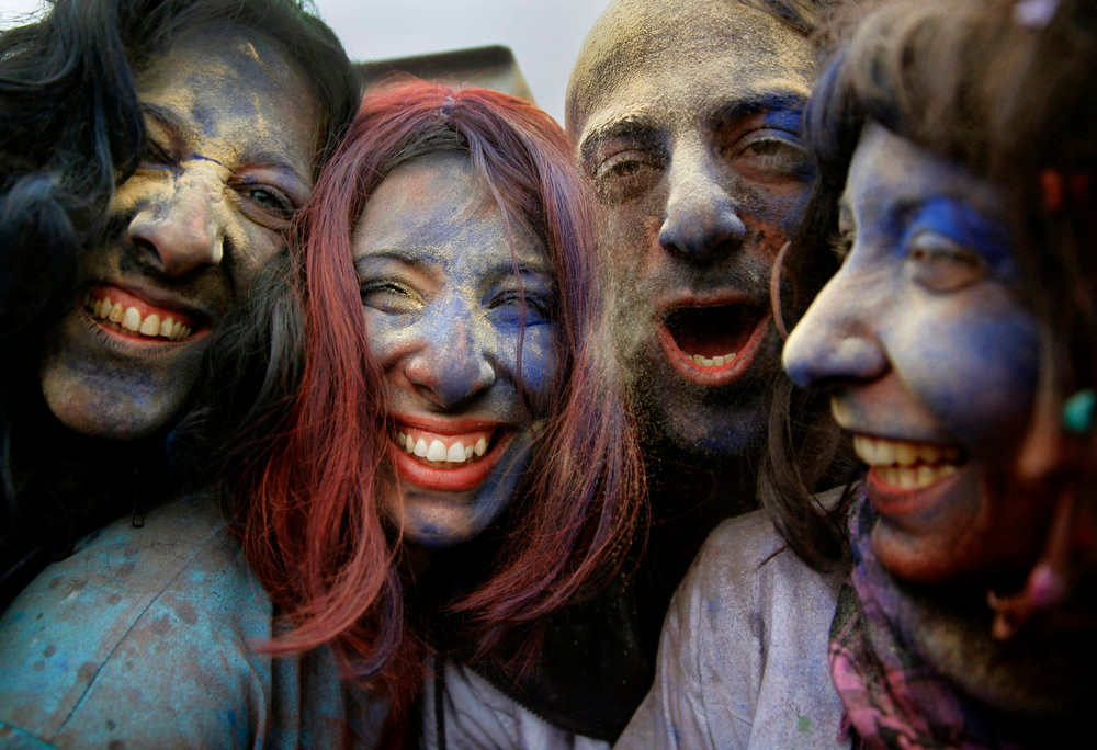 ". Revellers celebrate ""Ash Monday\"" by participating in a colourful \""flour war\"", a traditional festivity marking the end of the carnival season and the start of the 40-day Lent period until the Orthodox Easter,in the port town of Galaxidi, some 215kms (134 miles) north west of Athens, March 18, 2013. The revellers \""fight\"" by throwing coloured flour, charcoal dust and powder painting until they essentially run out of supplies. REUTERS/Yannis Behrakis (GREECE - Tags: SOCIETY)"