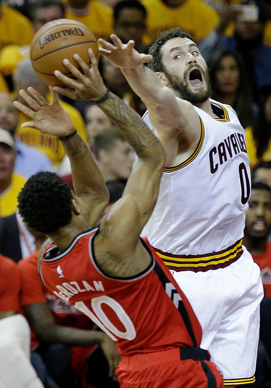. Cleveland Cavaliers\' Kevin Love (0) blocks a shot by Toronto Raptors\' DeMar DeRozan (10) during the first half of Game 2 of the NBA basketball Eastern Conference finals Thursday, May 19, 2016, in Cleveland. (AP Photo/Tony Dejak)