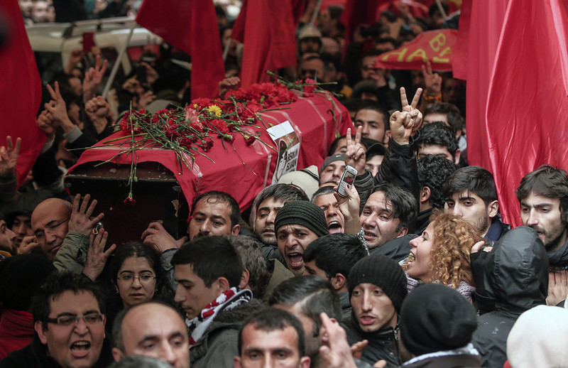. People carry the coffin of Berkin Elvan, a Turkish teenager who was in a coma since being hit on the head by a tear gas canister fired by police during last summer\'s anti-government protests, in Istanbul, Turkey, Tuesday, March 11, 2014. The 15-year old Berkin Elvan�s death in an Istanbul hospital nine months after he fell into a coma looked likely to spark new protests in Turkey. Elvan, who turned 15 in January was caught up in the protests on his way to a shop to buy bread. (AP Photo/Emrah Gurel)