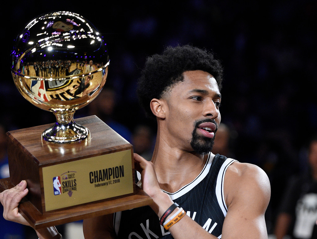 . Brooklyn Nets\' Spencer Dinwiddie holds up his trophy after winning the NBA All-Star basketball Skills Challenge, Saturday, Feb. 17, 2018, in Los Angeles.  (AP Photo/Chris Pizzello)