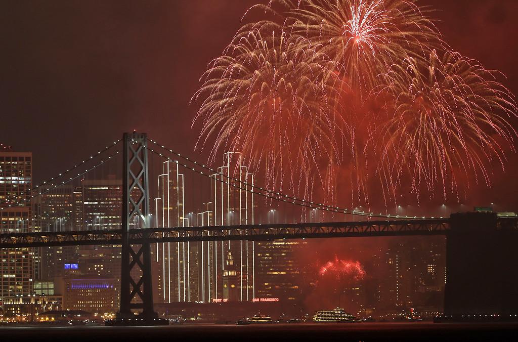 . Fireworks explode over the San Francisco Oakland Bay Bridge as part of New Year\'s Eve celebrations Sunday, Jan. 1, 2017, in San Francisco. (AP Photo/Marcio Jose Sanchez)