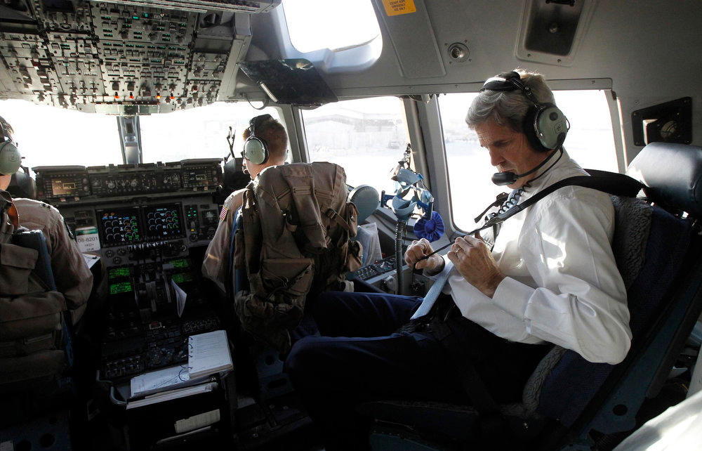 . U.S. Secretary of State John Kerry straps himself into the cockpit of an Air Force C-17 aircraft as he prepares to leave Baghdad following a short trip to the Iraqi capital, March 24, 2013. Kerry made an unannounced visit to Iraq on Sunday and said he told Prime Minister Nuri al-Maliki of his concern about Iranian flights over Iraq carrying arms to Syria.  REUTERS/Jason Reed