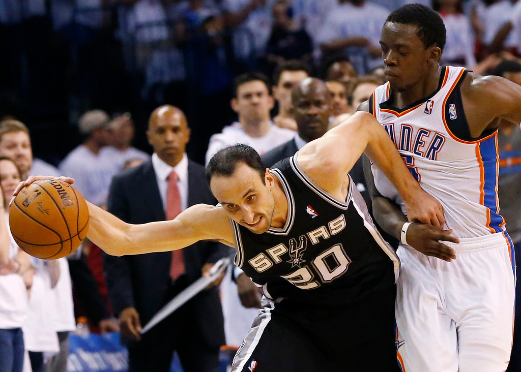 . San Antonio Spurs guard Manu Ginobili (20) is fouled by Oklahoma City Thunder guard Reggie Jackson in the final minute of the second half of Game 6 of the Western Conference finals NBA basketball playoff series in Oklahoma City, Saturday, May 31, 2014. (AP Photo/Sue Ogrocki)