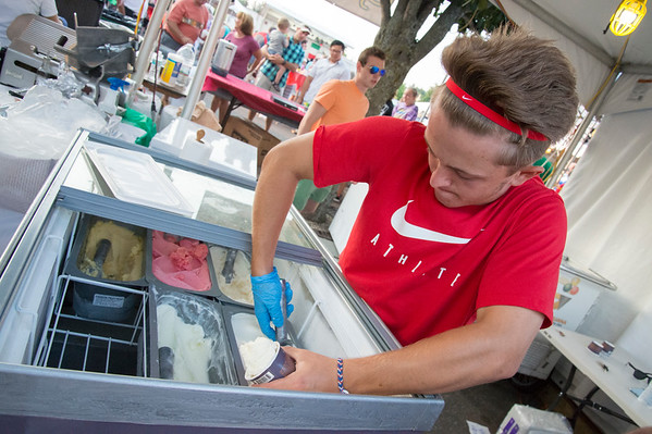 07/26/19 Wesley Bunnell | Staff Joe Gaudio scoops gelato for customers on the first night of the Italian Festival in Southington on Friday night.