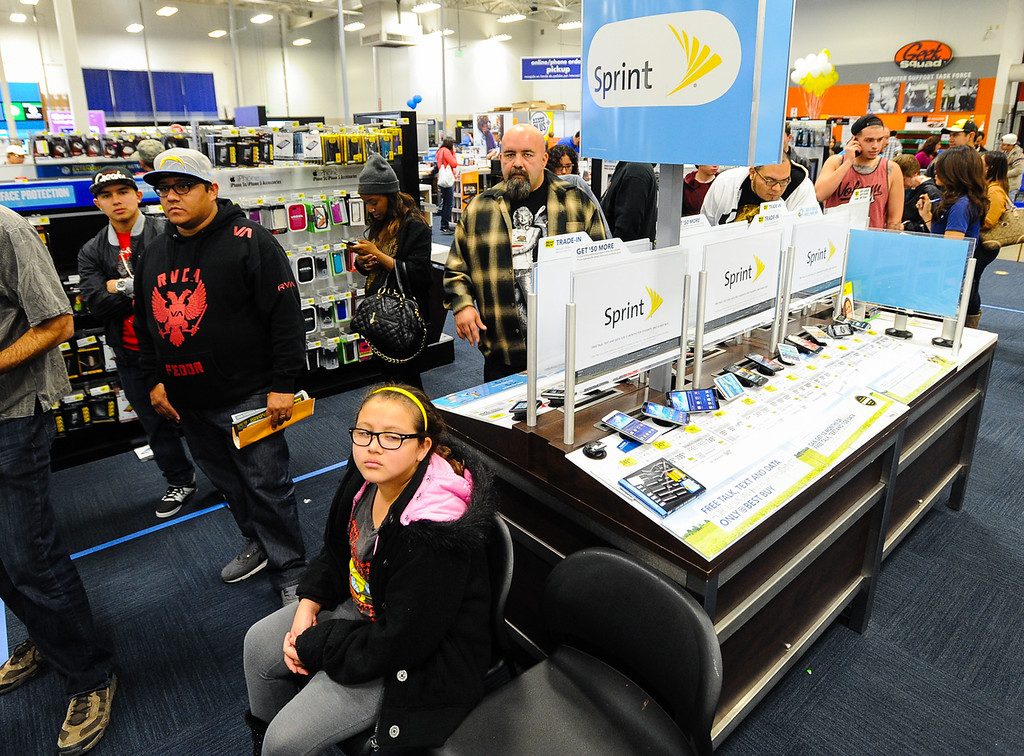 . Shoppers search for deals at Best Buy after the store opened its doors at 6 p.m. for early Black Friday sales on Thanksgiving in San Bernardino on Thursday, Nov. 28, 2013. Many retail stores pushed the boundary the Black Friday tradition this year with offering Black Friday deals on Thanksgiving day. (Photo by Rachel Luna / San Bernardino Sun)
