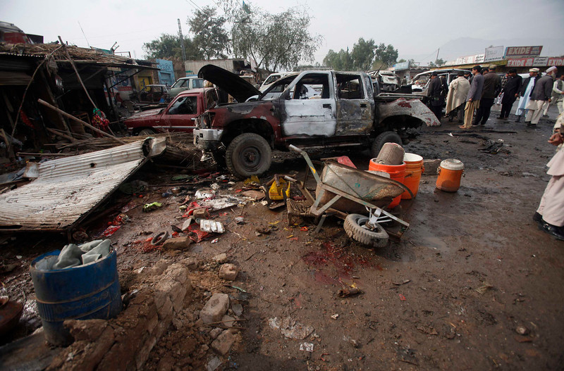 . A car which was damaged during a bomb attack is seen at Fauji Market in Peshawar December 17, 2012. The blast in the market in northwest Pakistan on Monday killed at least 15 people, a security official said. The official said at least 20 people had been wounded in the blast in the market in the Khyber region, near the border with Afghanistan, and the death toll could rise.  REUTERS/Fayaz Aziz