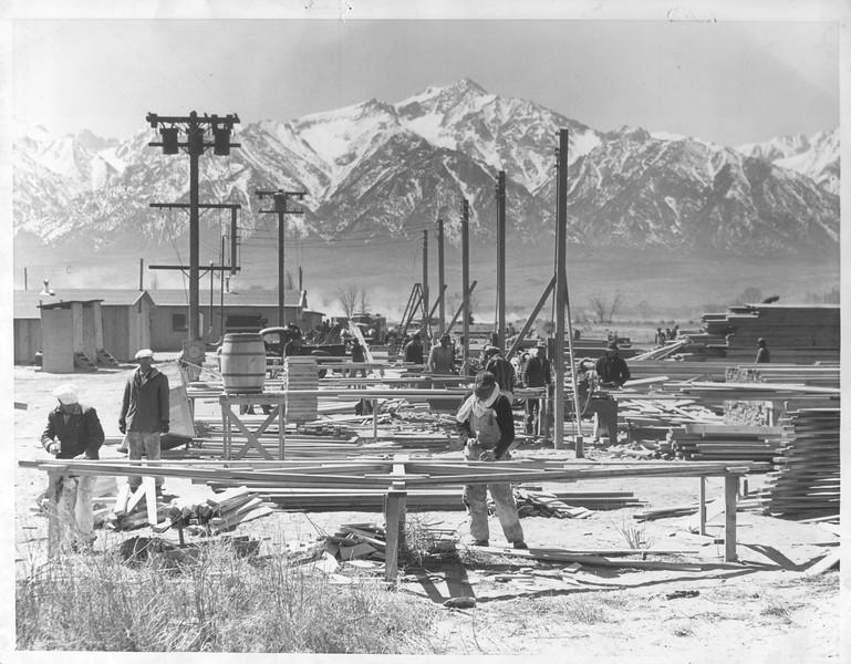 """""""Snowy Sierra Tower Over Evacuation Center"""" -- caption on photograph"""