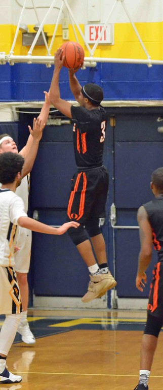 . Paul DiCicco - The News-Herald Orange\'s Jalen Warren shoots a jumper over an outstretched Wickliffe defender.