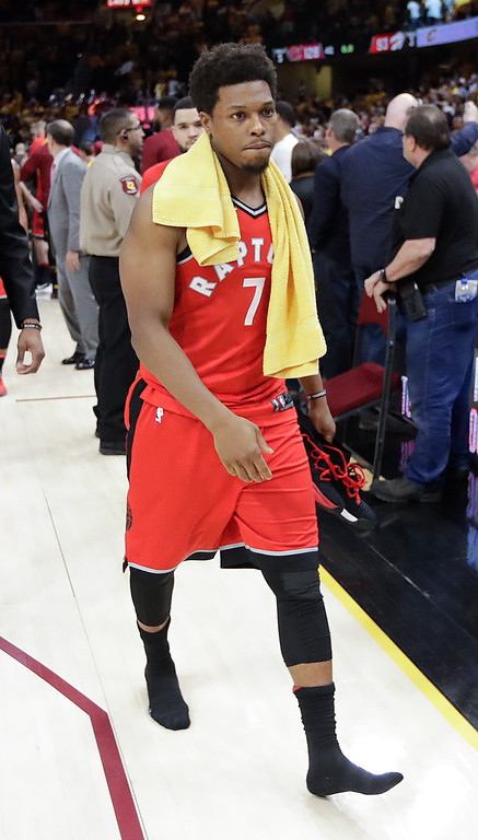 . Toronto Raptors\' Kyle Lowry walks off the court after a 128-93 loss to the Cleveland Cavaliers in Game 4 of an NBA basketball second-round playoff series, Monday, May 7, 2018, in Cleveland. (AP Photo/Tony Dejak)