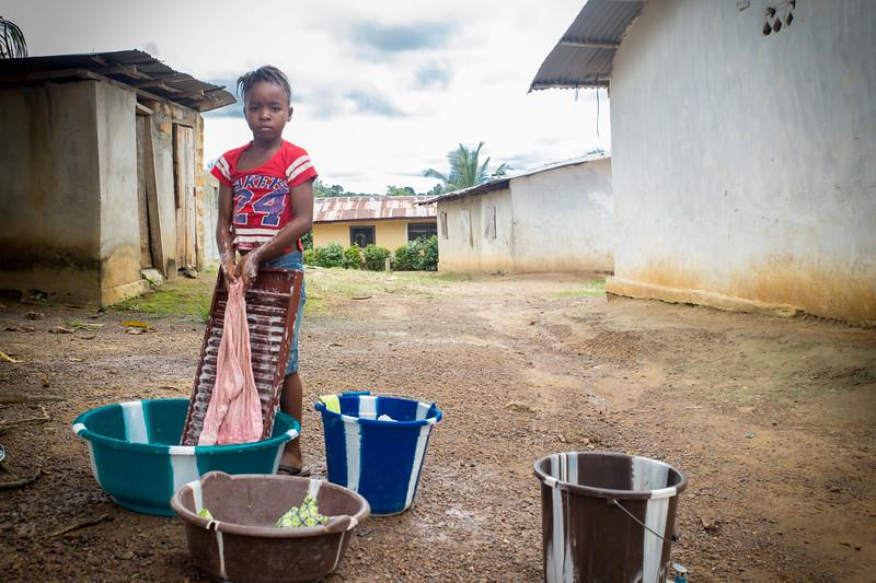 Monrovia, Liberia October 8, 2017 -  A young girl washes clothes.