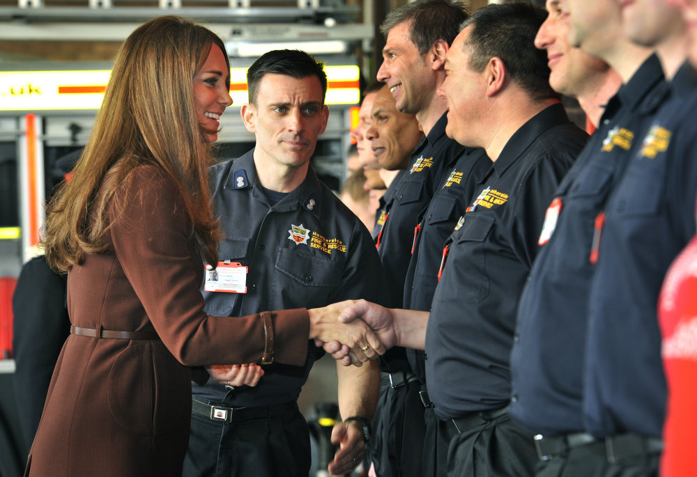 . Catherine, Duchess of Cambridge meets members of Green Watch at the station as she visits Humberside Fire and Rescue Peaks Lane Fire Station on March 5, 2013 in Grimsby, England.  (Photo Bruce Adams  - WPA Pool/Getty Images)