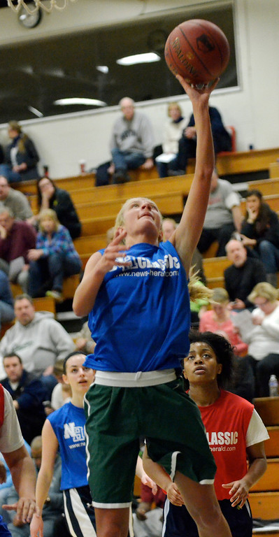 . Jeff Forman/JForman@News-Herald.com Jill Gibson goes up for a shot during the 36th News-Herald Classic March 29 at Lakeland Community College.
