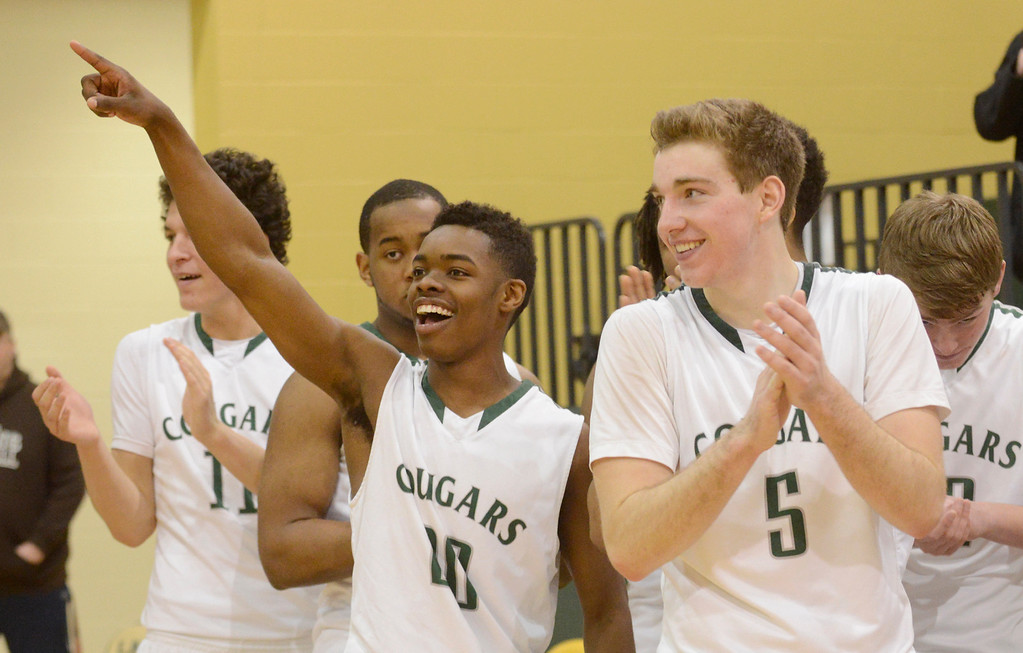 . Maribeth Joeright/MJoeright@News-Herald.com<p> Members of the Lake Catholic boys basketball team, Devonte Hennings, left, and Ben Meola celebrate their victory over Chagrin Falls in the Division II district final game, March 8, 2014.